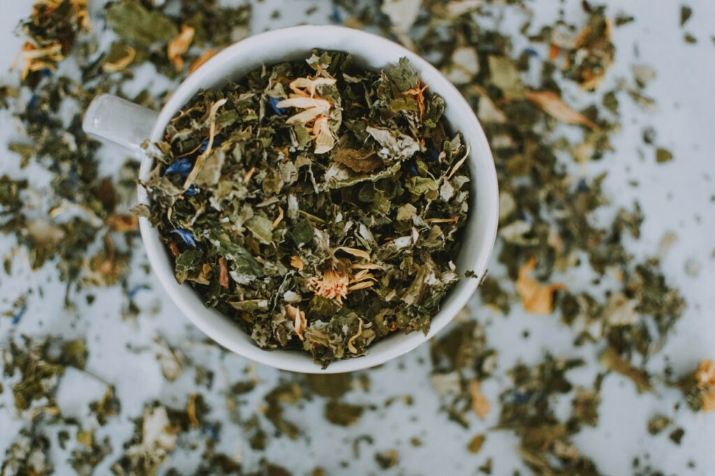 A cup of green tea leaves. A natural thermogenic.